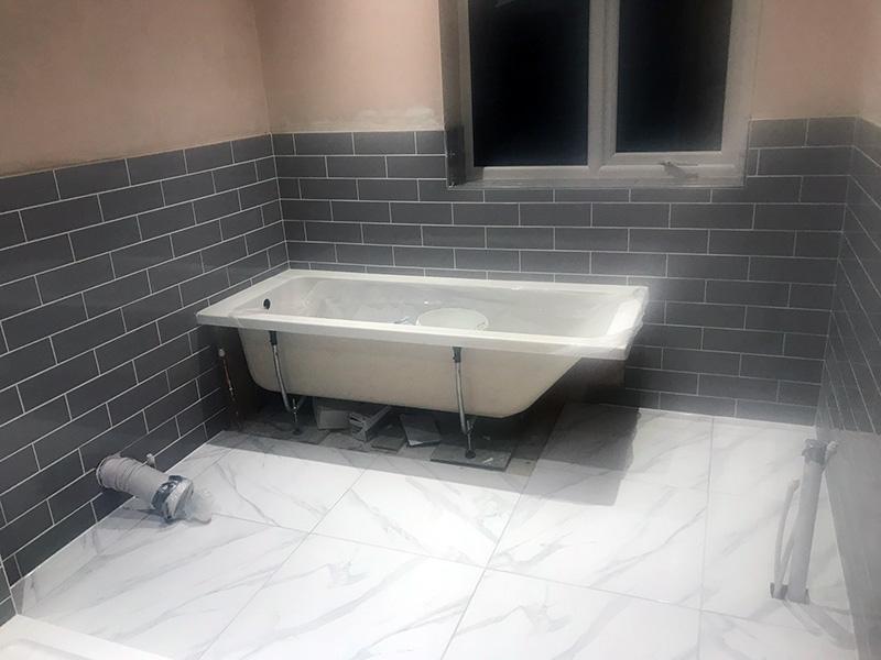 Bath being installed