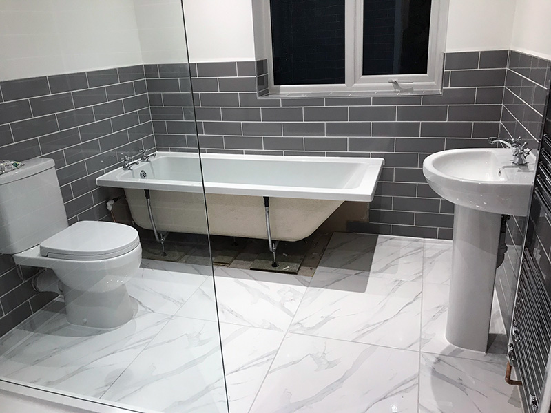 Bathroom tiled floor being fitted